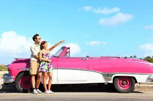young couple with convertible